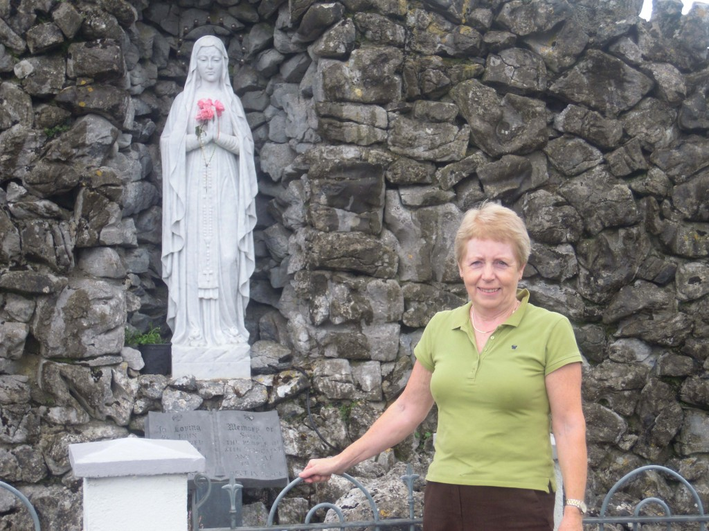 Fran Jennings at the grotto, Kiltormer Church