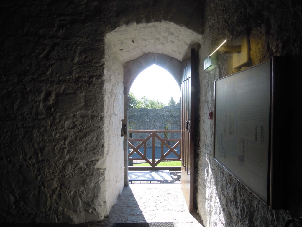 view of site of former curtain wall hall from entrance door of keep
